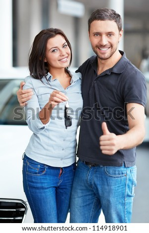 Young couple with car keys - stock photo