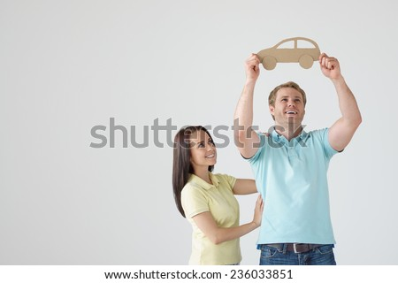 Young couple with cardboard car - stock photo