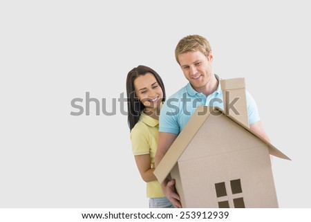 Young couple with cardboard sign