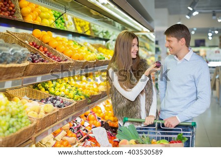 Young couple with cart - stock photo