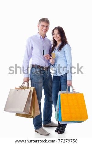 Young couple with credit cards and shopping on a white background - stock photo