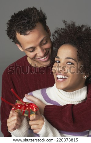 Young couple with gift - stock photo