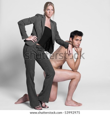 young couple with man naked in studio on isolated grey background - stock photo