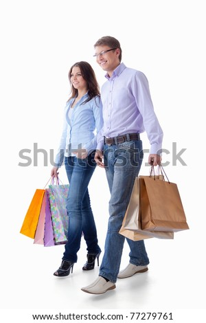 Young couple with packages on a white background - stock photo