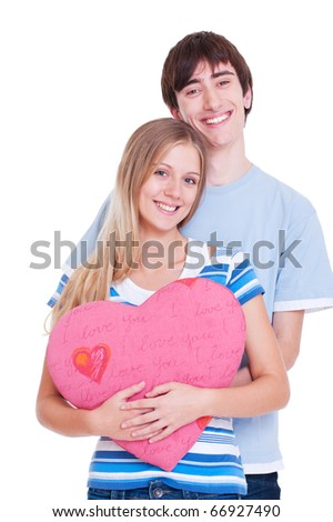 young couple with pink heart. isolated on white - stock photo