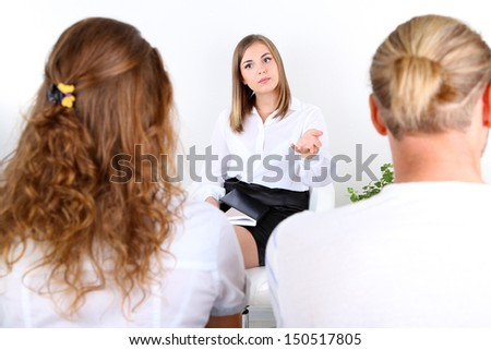 Young couple with problem on reception for family psychologist - stock photo
