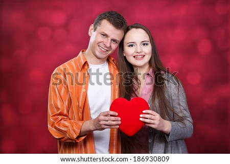 young couple with red  heart - stock photo