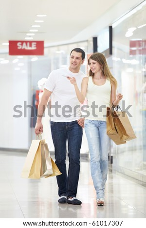 Young couple with shopping in store - stock photo