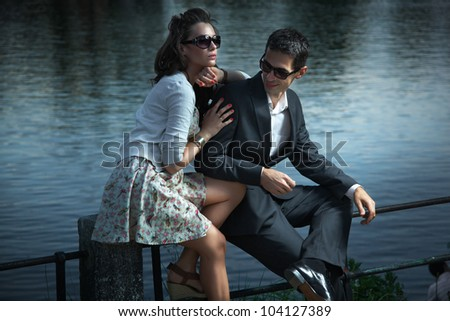 Young couple with sunglasses - stock photo