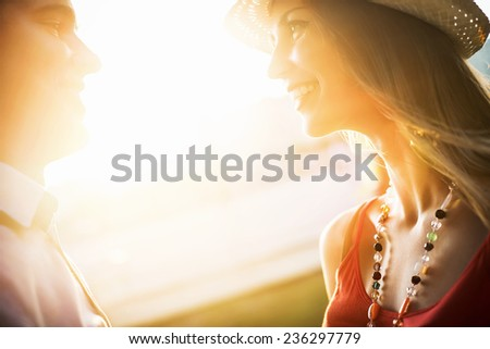 Young couple with sunlight - stock photo