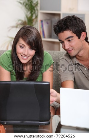 Young couple with their laptop computers - stock photo