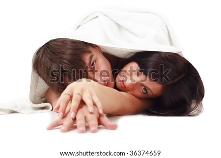 young couple with towel on a white background. - stock photo