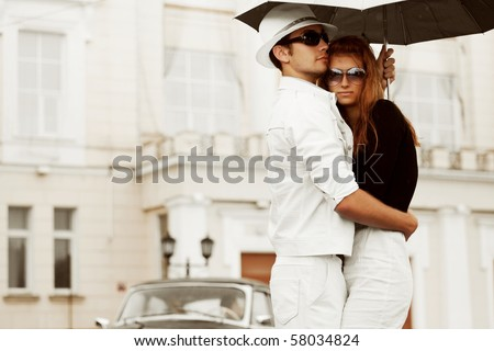 Young couple with umbrella. - stock photo