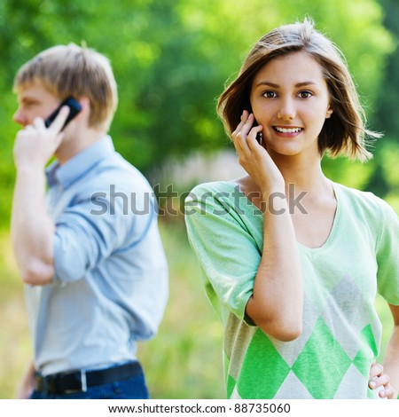 young couple woman man talking phone - stock photo