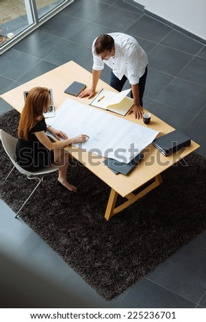 Young couple working and discussing in the office  - stock photo