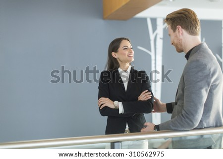 Young couple working in the office