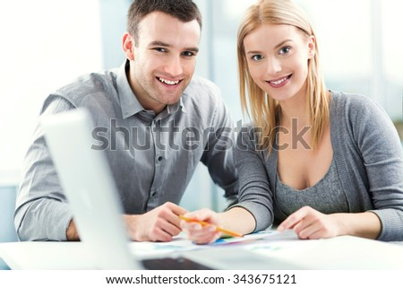 Young couple working together  - stock photo