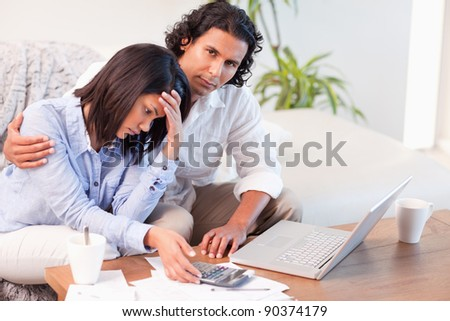 Young couple worried about their finances - stock photo