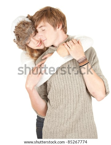 young couple - young winter woman kissing her boyfriend - stock photo