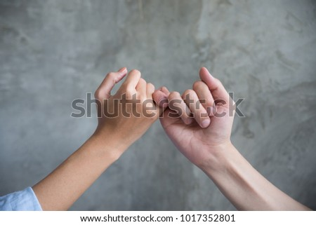 Young couples holding hand together. Symbol of reconciliation.