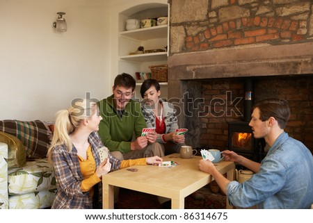 Young couples in cosy cottage - stock photo