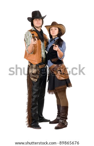 Young cowboy and cowgirl with a guns in hands. Isolated - stock photo