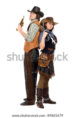 Young cowboy and cowgirl with a guns in hands. Isolated on white - stock photo