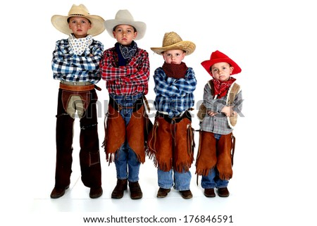 young cowboy brothers standing arms folded serious - stock photo