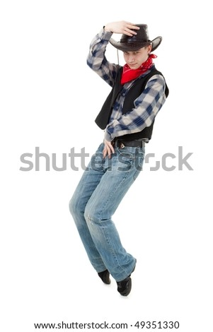 Young cowboy dancing on a white background - stock photo