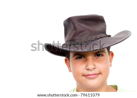 Young cowboy smiling, looking at camera, on white background - stock photo