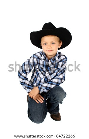 Young cowboy wearing a hat against white - stock photo