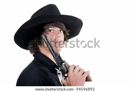 young cowboy with revolver and black hat
