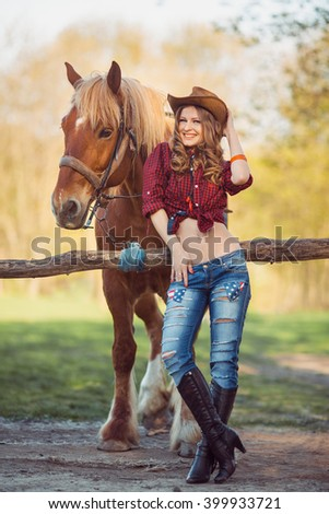 Young Cowgirl and Horse Outdoors. Sexy Fashion Model - stock photo