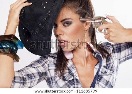 young cowgirl with gun on white - stock photo
