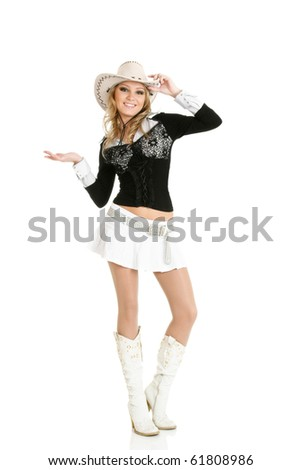 Young cowgirl woman dancing isolated over white - stock photo