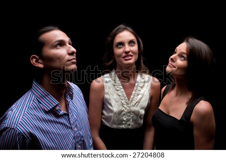 Young coworkers looking up with faith and hope for the future. - stock photo