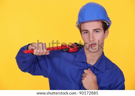 young craftsman holding a spanner