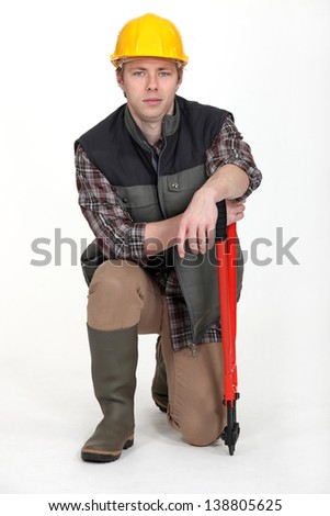 Young craftsman with spanner - stock photo