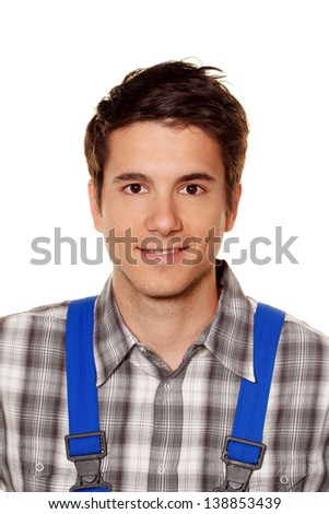 young craftsmen - plumber - construction worker in front of white background - stock photo