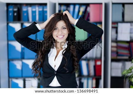 young crazy business woman posing on office background