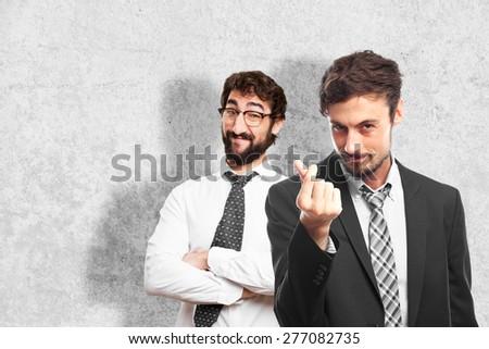 young crazy businessman money gesture - stock photo