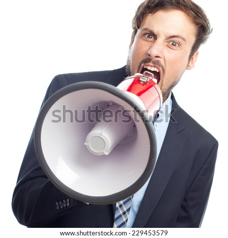 young crazy businessman shouting on megaphone