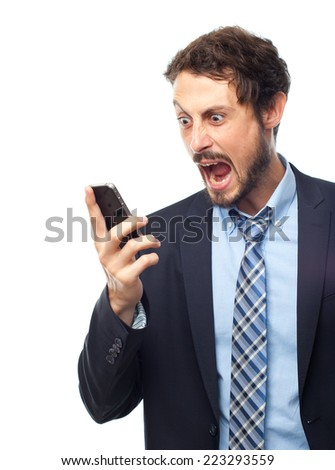 young crazy businessman shouting on phone