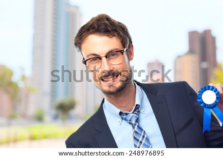 young crazy businessman with a medal - stock photo