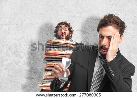 young crazy businessman worried about time - stock photo