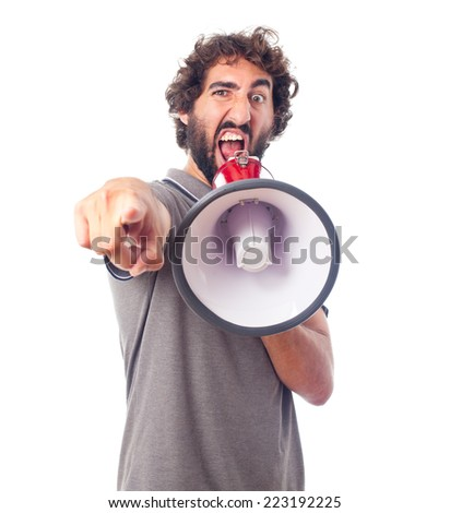 young crazy man angry with a megaphone - stock photo
