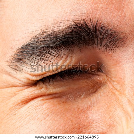young crazy man wink eye close up - stock photo