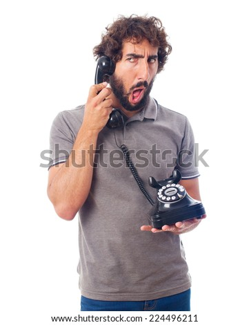 young crazy man with a phone - stock photo