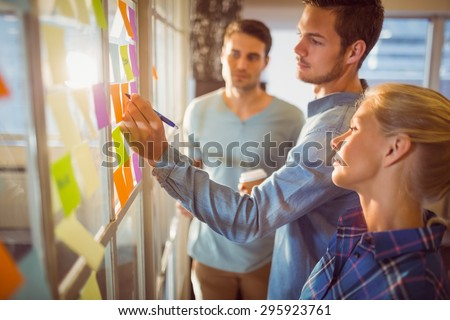 Young creative business people at office - stock photo