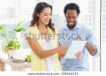 Young creative business people with mobile phone and digital tablet in the office - stock photo